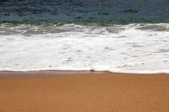 Sabbia ed onda della spiaggia Immagine Stock