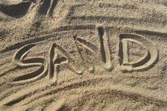 Sabbia scritta in sabbia Fotografia Stock Libera da Diritti
