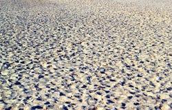 Sabbia sulla spiaggia che è stata camminata sopra Immagini Stock