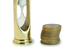 Sabbia-vetro e soldi Fotografie Stock