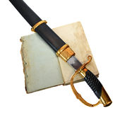 Saber in scabbard on old book Stock Image