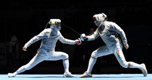 Saber World Fencing Tournament. Duel for Cup Grand Prix event, Eun S.Oh (KOR) and Zsolt Nemcsik (HUN) compete at the 2010 RFF Moscow Saber World Fencing stock image