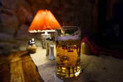 SABILE, LATVIA - APRIL 21, 2019: Glass of Uzavas light beer at a Krogs restaurant royalty free stock image