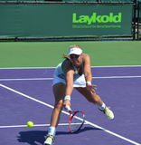 Sabine Lisicki. Of Germany digging out a low volley jn a first round match at the Sony Open Tennis Championships on 20 March 2013, Ms, Lisicki lost to her stock images