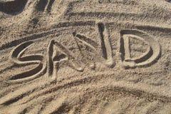 Sable écrit en sable photographie stock