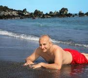 sable d'homme de couleur de plage photographie stock libre de droits