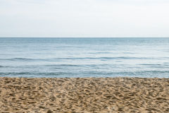 Sable de mer et texture claire de ciel Photos libres de droits