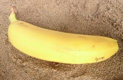 Sable et banane Photo libre de droits