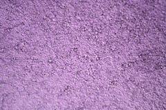 Sable et ciment secs roses pourpres Images stock