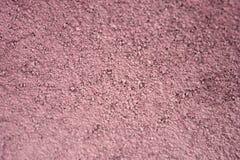 Sable et ciment secs rougeâtres Photo stock