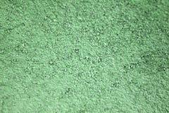 Sable et ciment secs verts Image stock