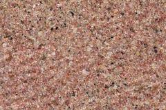 Sable rose de plage Image libre de droits
