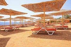Sable rouge en plage de cheik d'EL de Sharm Photos libres de droits