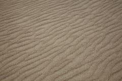 Sable sur la plage Images stock