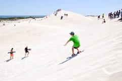 Sable surfant Lancelin Dunes images stock