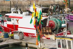 Closeup of flags hung on floats on fishing boats Royalty Free Stock Photos