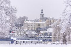 Saborna Crkva, Beograd, Srbija. Church of St. Michael and surrounding architecture, Belgrade, Serbia, through snowy and frozen trees, during very cold, winter stock photos