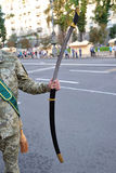 Sabre in serviceman's hand Royalty Free Stock Photos