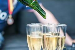 Sabrera champagne för berömmen arkivbild