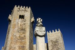 Sabugal castle. Traditional portuguese castle with the city heraldry carved on the pillory royalty free stock photo