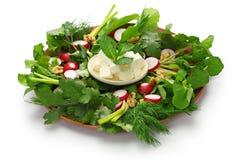 Sabzi khordan, iranian cuisine. Sabzi khordan, assortment of fresh herbs and raw vegetables salad, iranian cuisine  on white background Royalty Free Stock Image