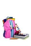 Sac à dos rose avec des approvisionnements d'école avec l'espace de copie Photographie stock libre de droits