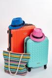 Sac à main de femme et valises colorées Images libres de droits