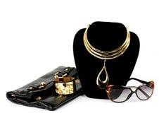 Sac à main et bijou d'or Image libre de droits