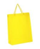 Sac à provisions jaune d'isolement sur le fond blanc Photo libre de droits
