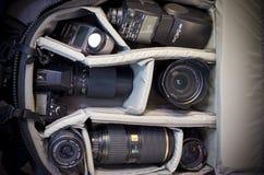 Sac d'appareil-photo et équipement de photo Images libres de droits