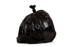 Sac d'ordures en plastique noir sur le blanc photographie stock libre de droits