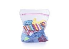 Sac de blanchisserie avec des vêtements pour le lavage photos stock