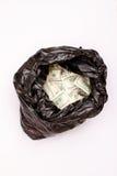 Sac de déchets avec des dollars Photo libre de droits
