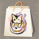 Sac de papier avec le chat Image stock