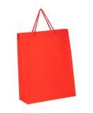 Sac de papier d'achats rouges d'isolement sur le blanc Photo libre de droits