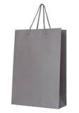 Sac de papier gris d'isolement sur le blanc photo libre de droits