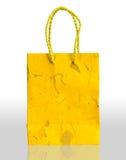 Sac de papier jaune Photos libres de droits
