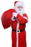 Sac de Santa Claus sur les cadeaux arrières de Noël d'isolement sur le blanc Photographie stock