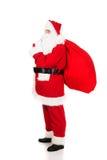 Sac de transport de Santa Claus avec des présents Images libres de droits