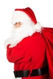 Sac de transport de Santa Claus avec des présents Images stock