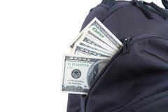Sac à dos avec des billets de banque du dollar Images stock