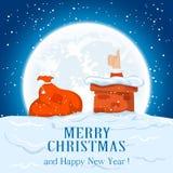 Sac et Santa sur le toit Photos libres de droits