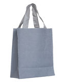 Sac gris de toile d'isolement sur le fond blanc Photos stock