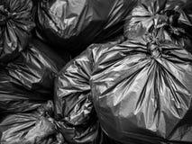 Sac noir de déchets photographie stock