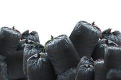 Sac noir des déchets d'isolement sur le fond blanc photo stock