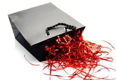Sac noir et rouge de cadeau Image libre de droits