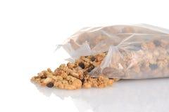 Sac renversé de céréale d'amande de raisin sec de granola Images libres de droits
