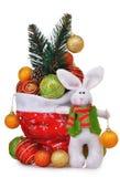 Sac rouge de Santa Claus avec les jouets et le lapin de Noël Photos libres de droits
