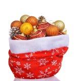 Sac rouge du père noël avec des jouets de Noël Photos libres de droits