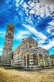 Saccargia-Kathedrale unter Wolken Lizenzfreie Stockfotos